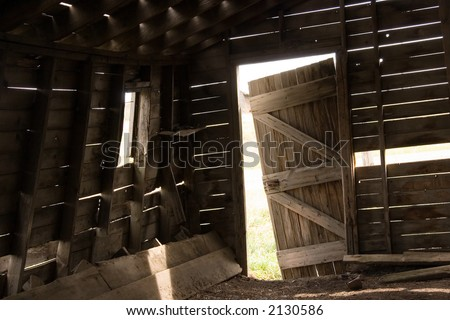 Barn Door Falling Off Its Hinges Stock Photo 2130586