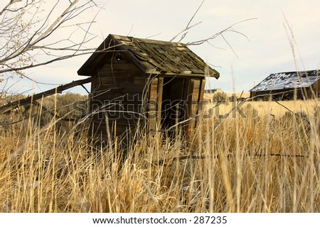 barn old abandoned well outhouse toilet snow fall winter sky blue white brown grass ice cold antique vintage