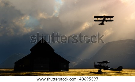 Barn stormers,  storm clouds over mountains silhouettes  old barn. One double wing plane soars into the air as the other vintage biplane stands ready. dramatic Landscape with room for text