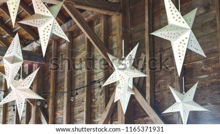 Barn wedding decorations, star lights paper star lights hanging in a barn #1165371931