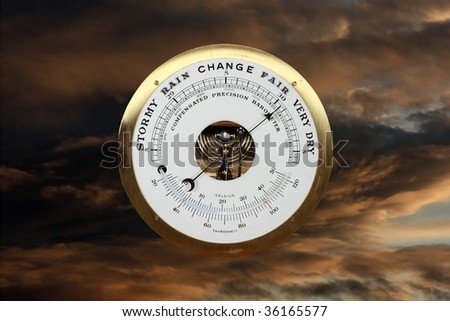 Barometer against a stormy sky
