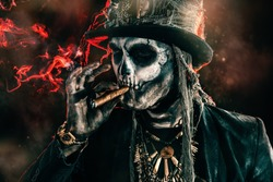 Baron Saturday. Baron Samedi. A man with a skull makeup dressed in a tail-coat and a top-hat. Dia de los muertos. Day of The Dead. Halloween.
