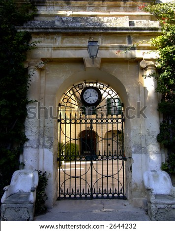 Baroque Architecture on Baroque Architecture Gate And Modern Clock On Medieval Building In