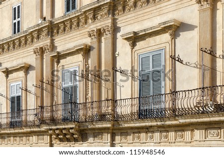 Baroque balconies in the city of Noto, Sicily