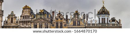 Baroque building facade boasts fine architecture and magnificent rooftop decorations in the Grand Place. Opulent exterior with guildhalls and renaissance outstanding ornaments - Brussels, Belgium
