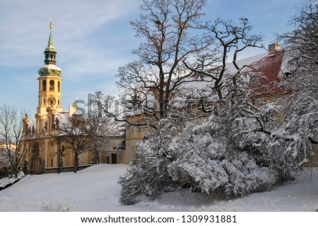 Baroque historic monument, a place of pilgrimage Loreta, covered with snow. Hradcany district in Prague, Czech republic. Concept: Winter travel to Prague, Travel Blogging #1309931881
