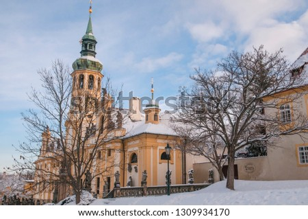 Baroque historic monument, a place of pilgrimage Loreta, covered with snow. Hradcany district in Prague, Czech republic. Concept: Winter travel to Prague, Travel Blogging #1309934170