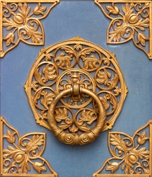 Baroque wrought-iron fence element, vintage, close up