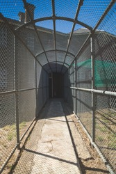 barred tunnel on the prison walker