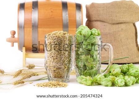 Barrel mug with hops. Isolated on a white background.
