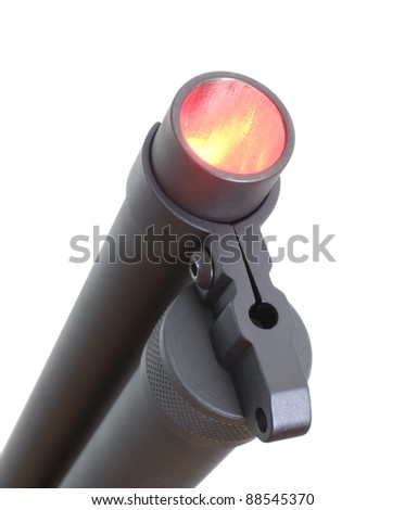 Barrel of a shotgun glowing from within in red and yellow - stock photo