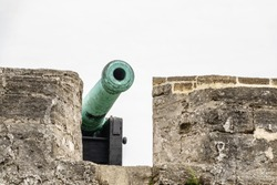 Barrel of replica antique cannon deployed on a rampart at Castillo de San Marcos, a fortress built from 1672 to 1695 in St. Augustine, Florida, and now a national monument, for concepts of protection