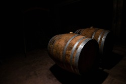Barrel of wine in a winery in a obscure place
