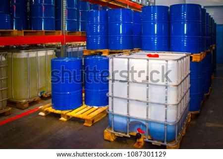 Barrels of chemicals. Chemistry. Metal barrels for chemical products.