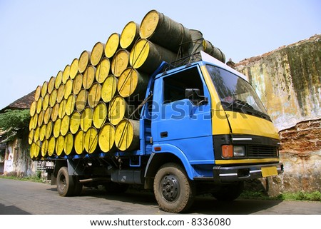 barrels stacked atop truck, south india