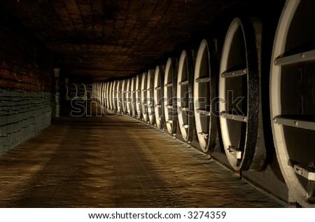 Barrels stock in cellar of winery