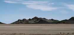 Barren mountains on rocky desert landscape