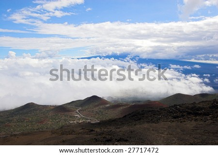 Barren volcanic landscape and blue sky in Hawaii