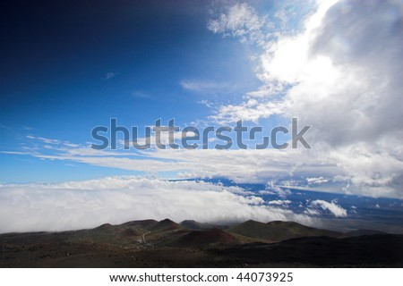 Barren volcanic landscape and blue sky in Hawaii - stock photo
