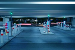 Barrier at Entrance and exit of a car Parking garage. barrier in a car park. Exit from underground parking. Underground parking/garage. Interior of parking. Toning