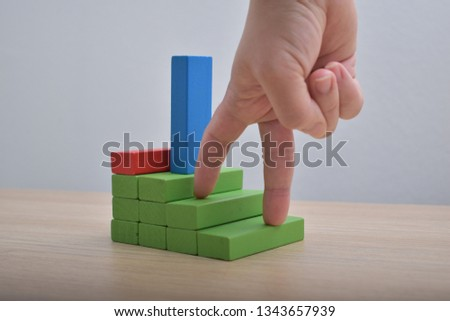 Barrier in the way Wooden blocks ladder and fingers career path concept #1343657939