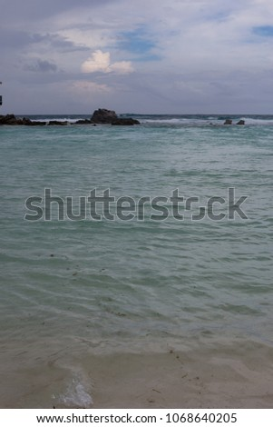 Barrier lagoon with crystal aqua waters and cloudy skies #1068640205