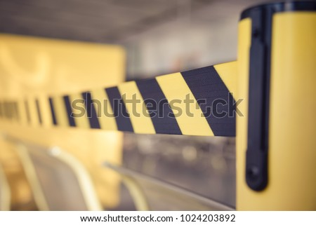 Barrier tape for no entry. Restricted area. Black And Yellow Lines. Do Not Cross, Danger, Do Not Enter