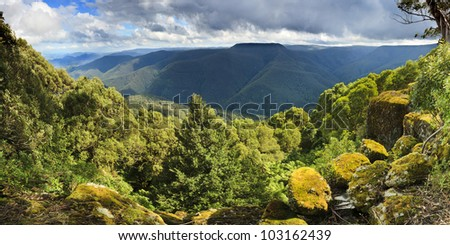 Barrington Tops Thunderbolt lookout view on mountain valley in blue mountains with eucalyptus forest under cloudy sky