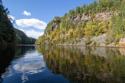 Barron River which flows through Barron Canyon is a popular paddle route in Algonquin Park with stunning views of granite walls and vegetation reflected in the calm water