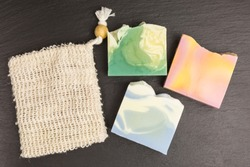 bars of eco friendly solid shower gel and soap bag to avoid plastic packaging - zero waste concept