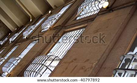 Bars shown on the windows of Jail.  Prison windows shot on Alcatraz Island in San Francisco, California.