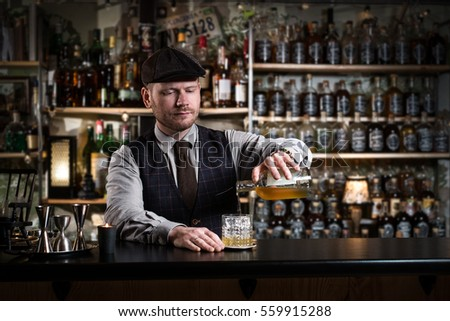 Bartender bartender is pouring a drink #559915288