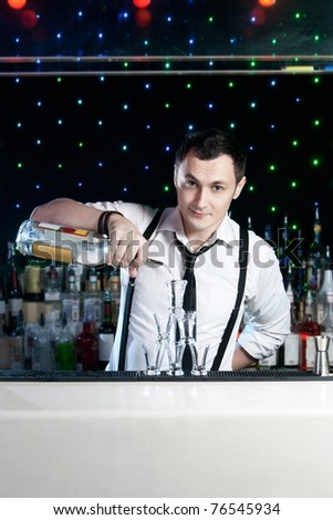 Bartender bartender is pouring a drink