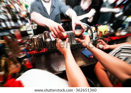 Bartender gives ready cocktails. alcoholic beverage in his hand