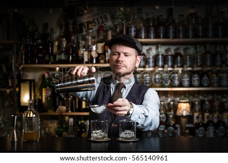 Bartender is pouring a drink #565140961