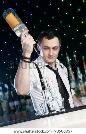 Bartender  is pouring a drink