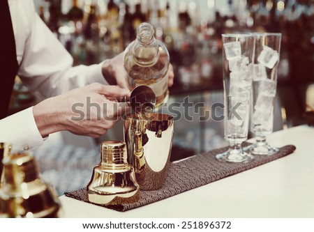 bartender is pouring liquor in...