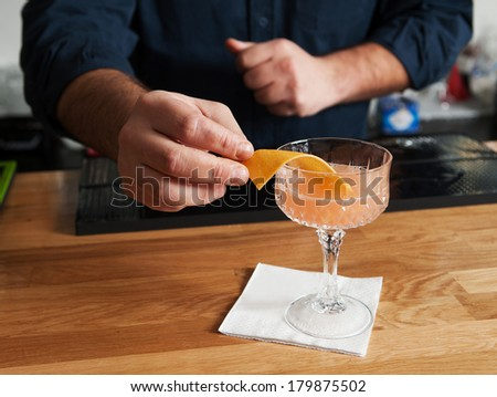 bartender making cocktails and serves