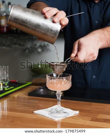 bartender making cocktails and serves a