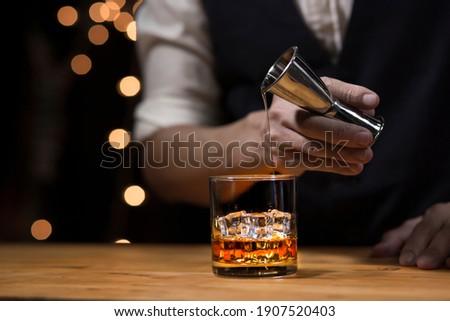 Bartender Serve Whiskey, on wood bar,  ストックフォト ©