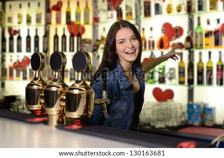 Bartender shows some alcoholic beverages
