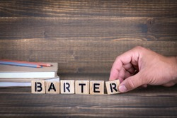 Barter concept. Wooden letters on the office desk, informative and communication background