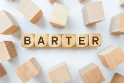 Barter word on wooden cubes