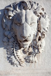 Bas relief of lion .  Animal sculpture carved into a wall