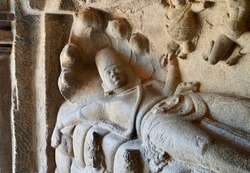 Bas relief of Lord Vishnu sculpture lying in the bed of Five headed snake is prominently carved in the monolithic rock cut cave temple in Mahabalipuram, Tamilnadu. India rock art of relief sculptures.