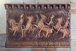 Bas relief of the ancient soldiers on the battle horses