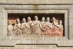 Bas-relief of the souls in purgatory on fire on the facade of the church of Las Animas in Santiago de Compostela