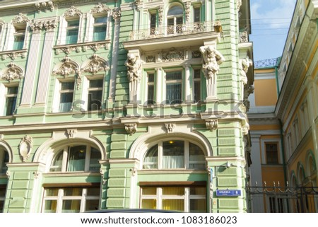 """Bas-relief on the building of 1890. One of the street in the historic center of Kitay-town of Moscow, Russia.  Inscription in Russian is """"Ilyinka"""" street. #1083186023"""