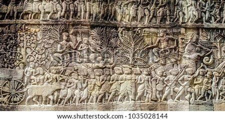 Bas relief sculpture, elephant charging into battle and the battle between the Cham and Khmer. The battles conducted by Jayavarman VII against the invading Cham. Bayon Temple, Angkor Thom, Seam Reap. #1035028144