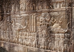 Bas-relief sculpture of the Khmer army of warriors and elephants going to battle. Prasat Bayon temple, Angkor Thom, Cambodia